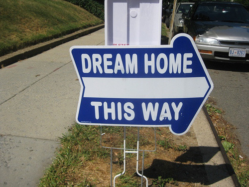 Dream home this way sign